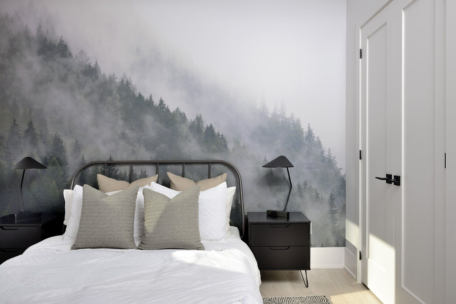 Neutral bedroom with forest wallpaper.