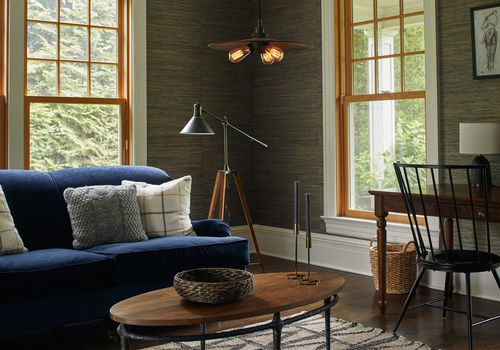 Moody living space with blue sofa.