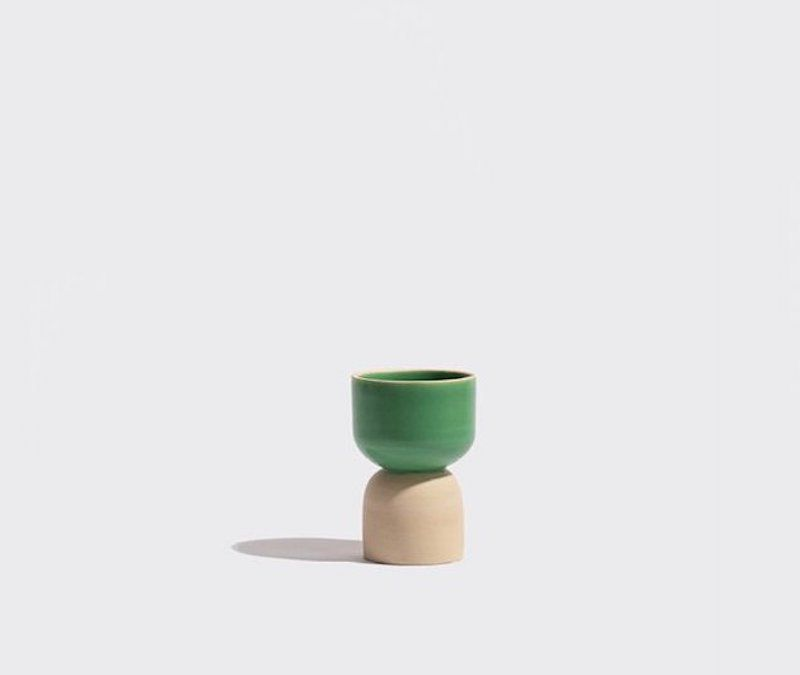 A small green ceramic cup, currently for sale at Yowie