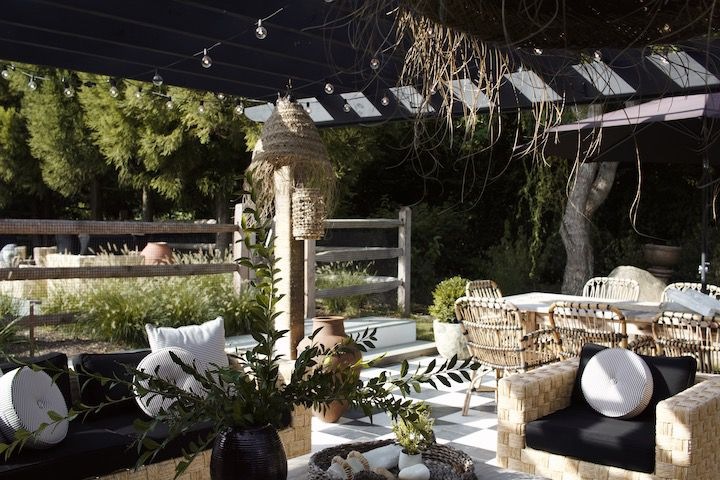 Outdoor living space with large dining table and couch.