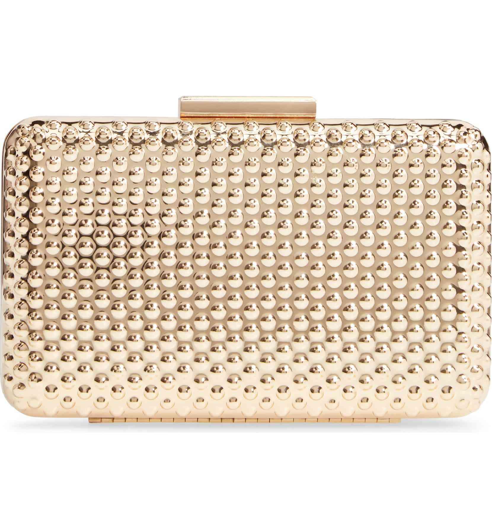 A gold tone box-shaped clutch purse.