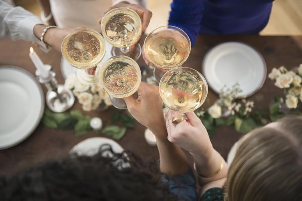 Women toasting each other with champagne