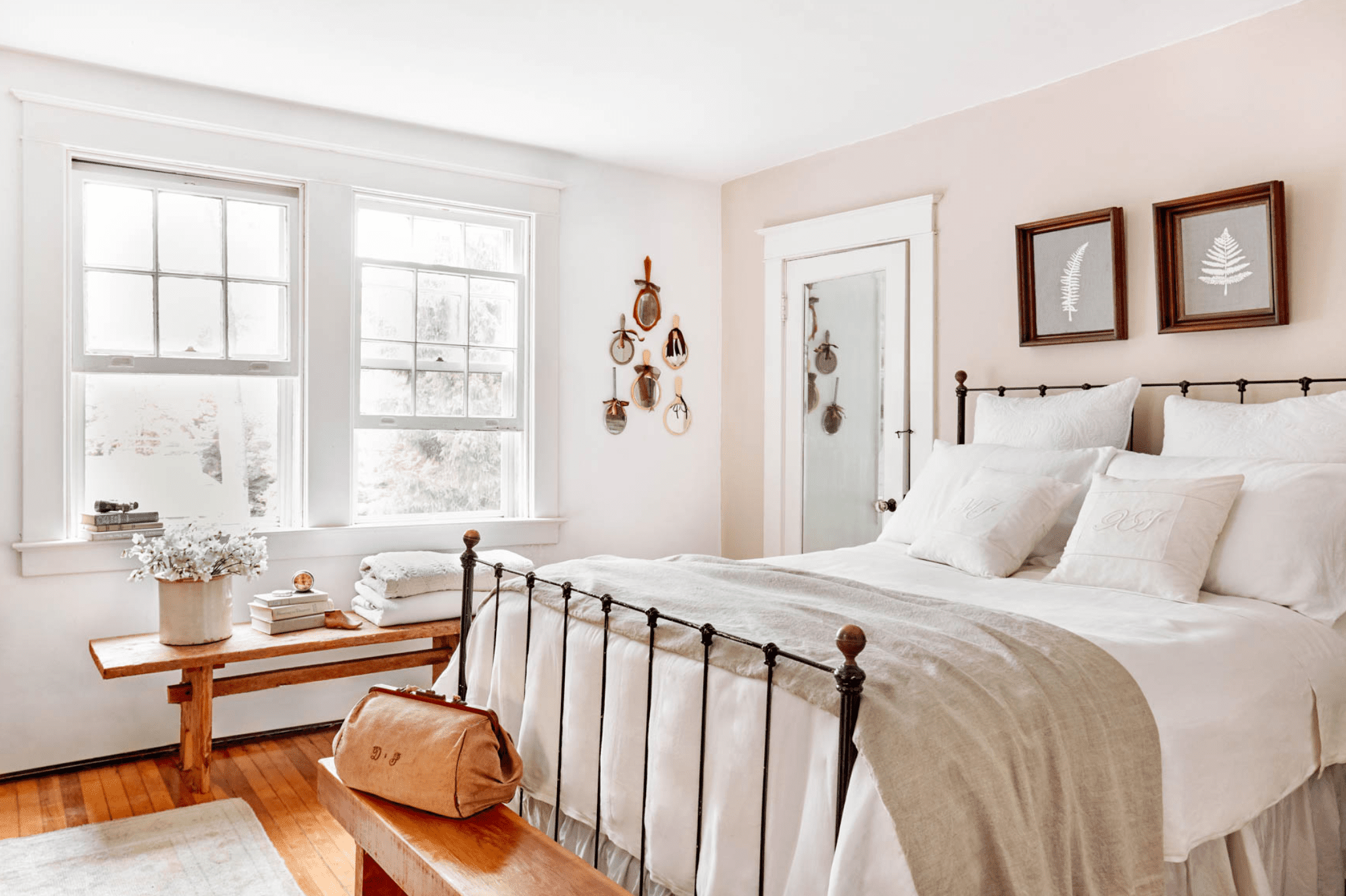 Bright bedroom with blush pink accent wall.