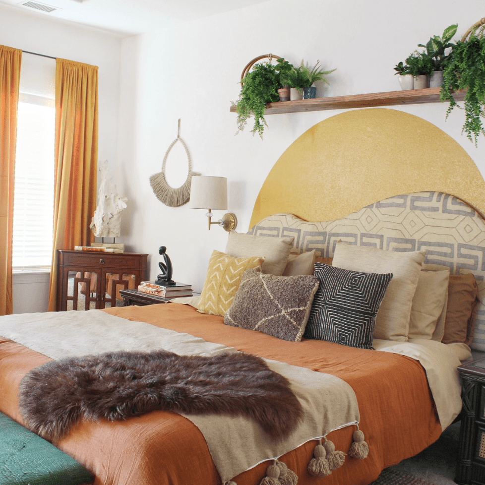 A bedroom full of earthy colors and prints
