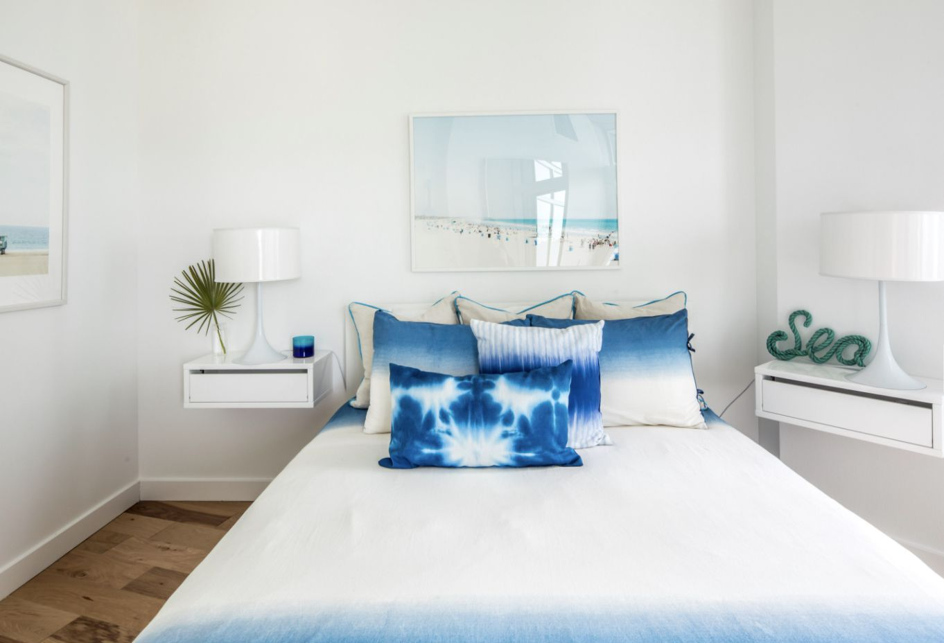 bedroom with floating shelves for nightstands