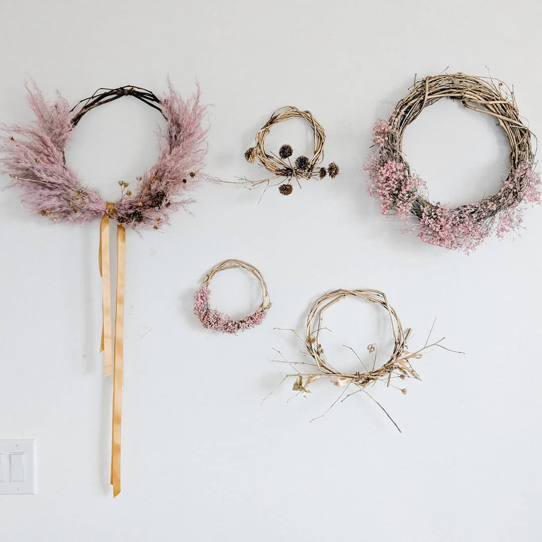 Floral wreaths hanging from a wall