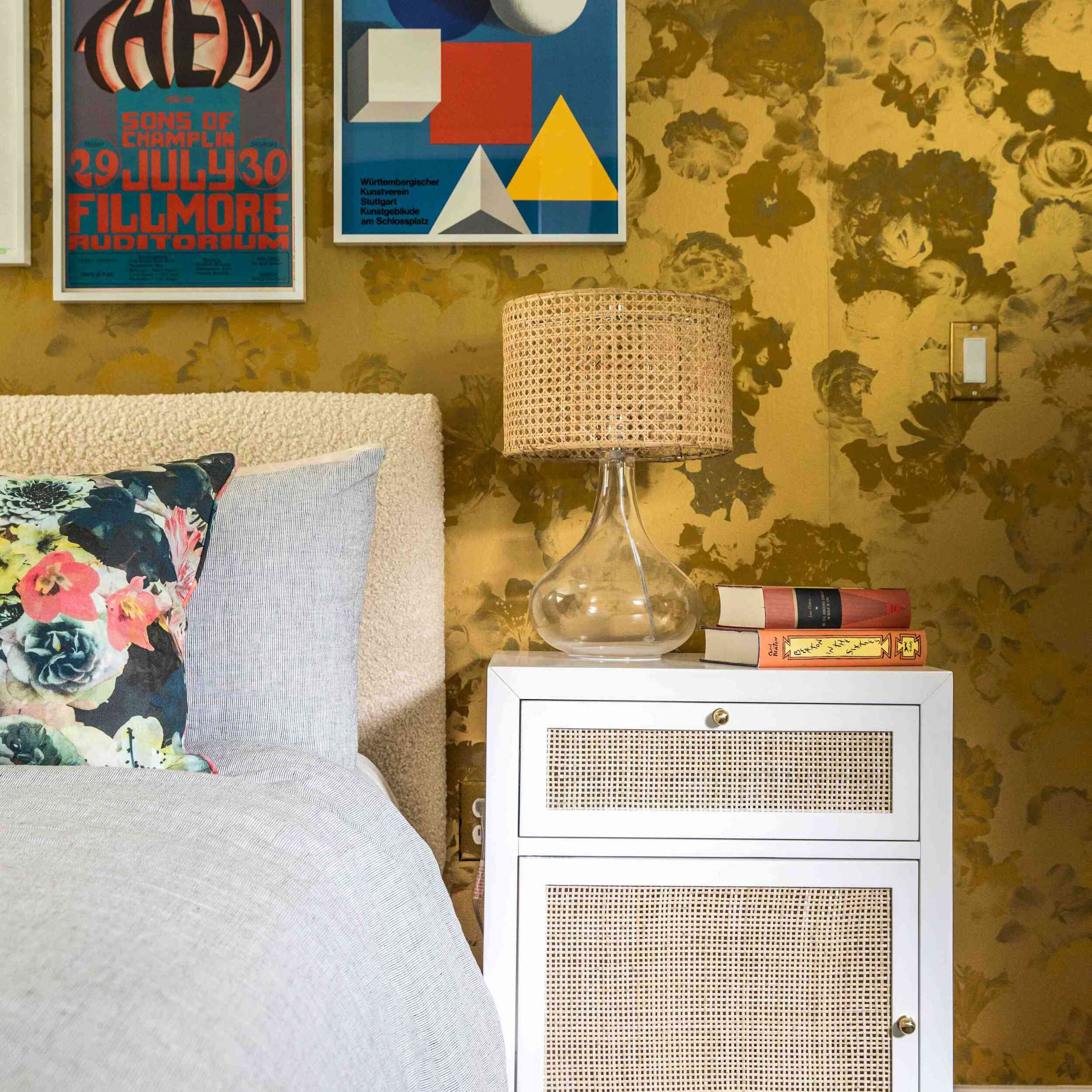 Funky bedroom with rattan lampshade.