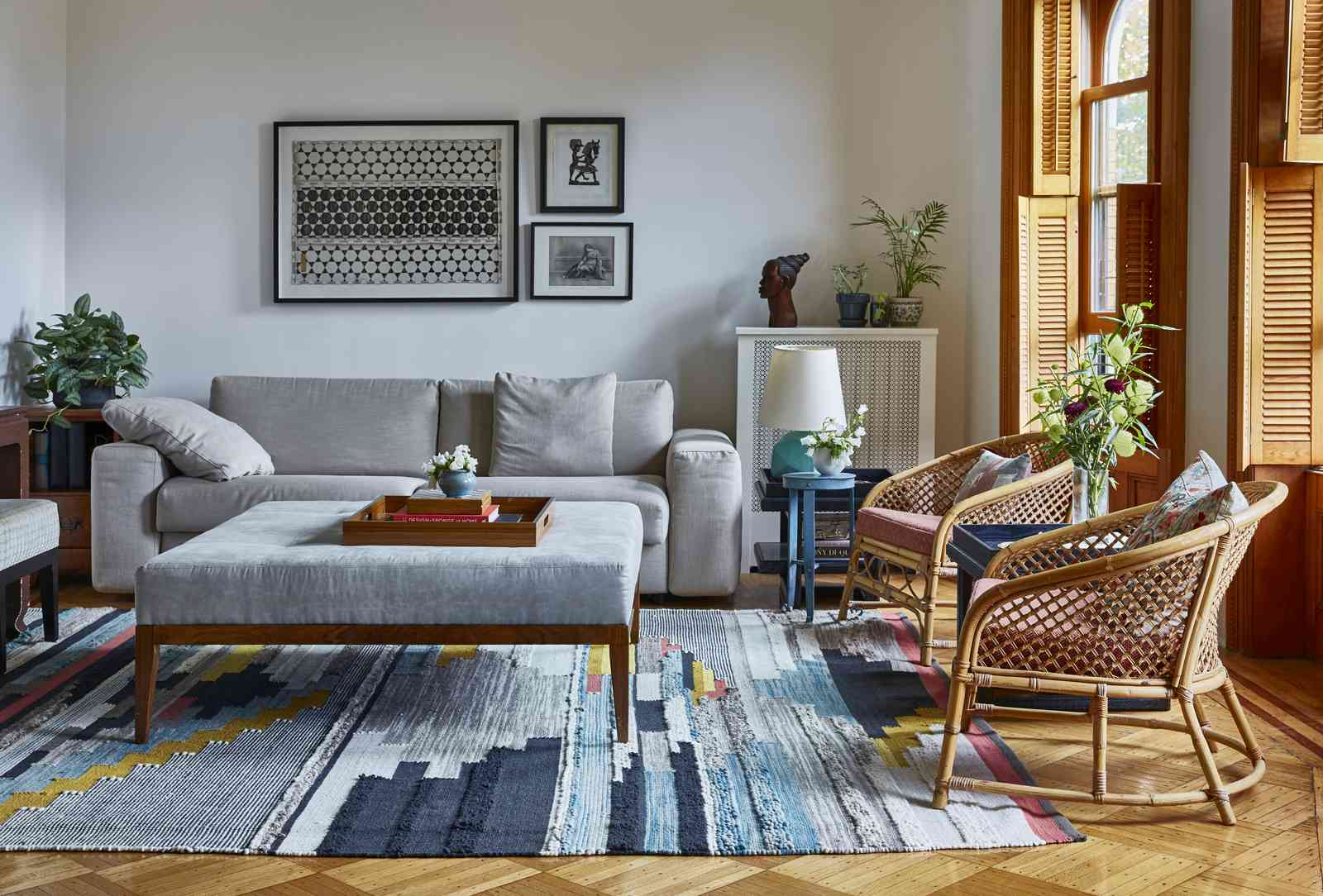 White living room and colorful rug