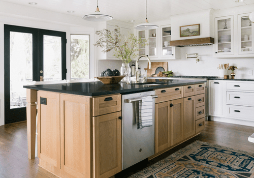 Large wood island with stainless steel dishwasher.