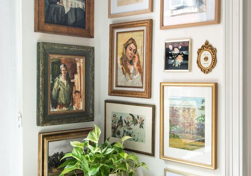 Corner with plant and vintage gallery wall.