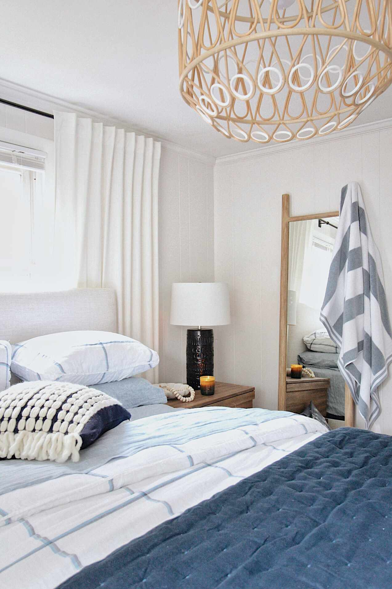 Bedroom with a candle and blue bedding