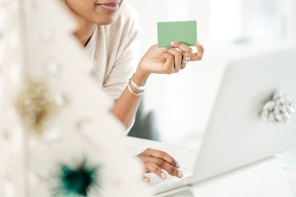 Woman with gift card.
