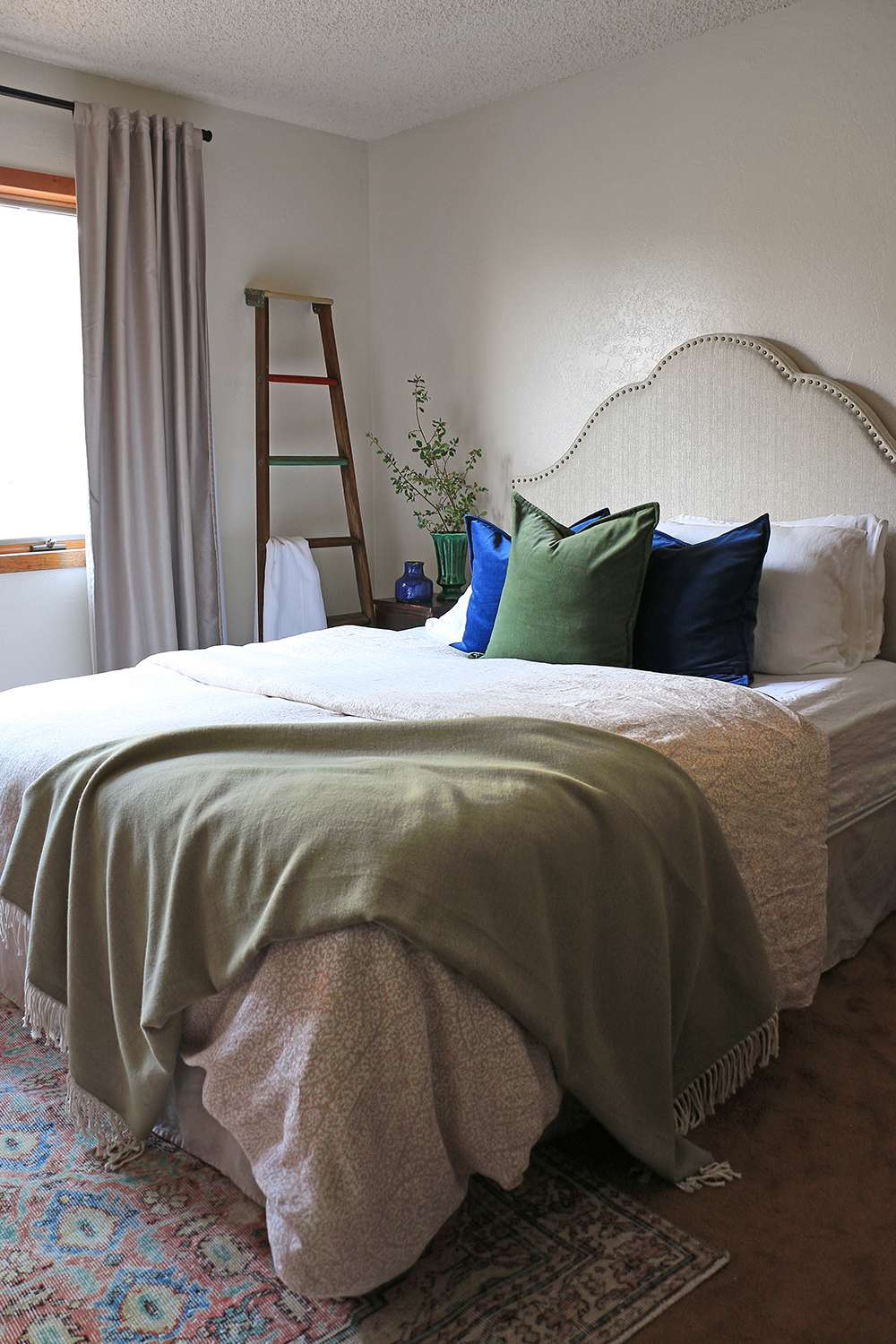 Green and blue accents in a bedroom