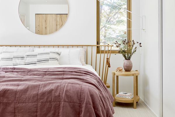 bright bedroom with berry quilt