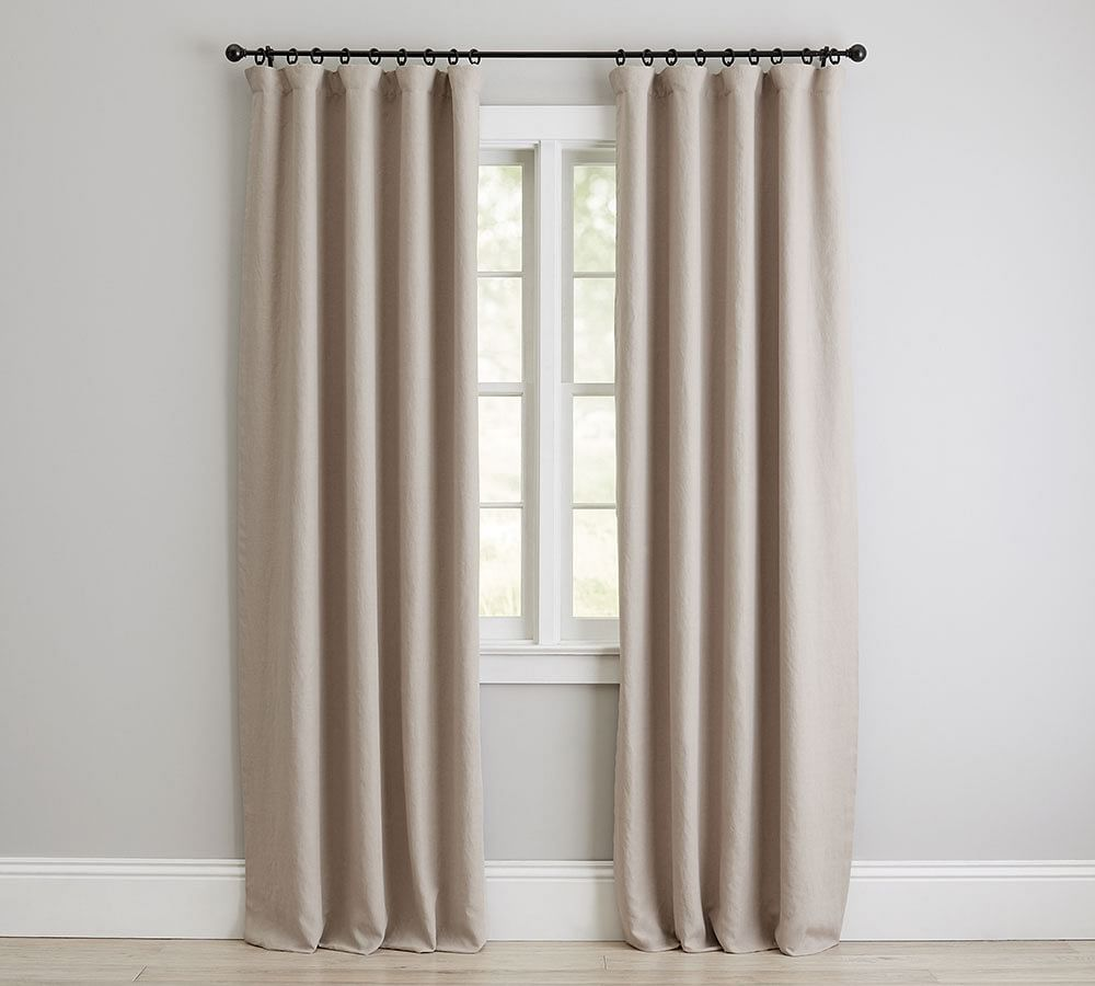 A set of off-white drapes, currently for sale at Pottery Barn