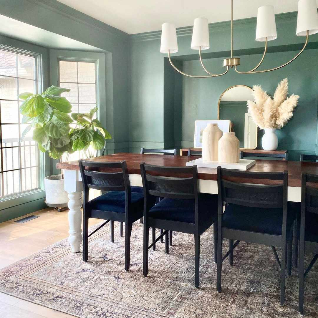 Dining room with blue green paint