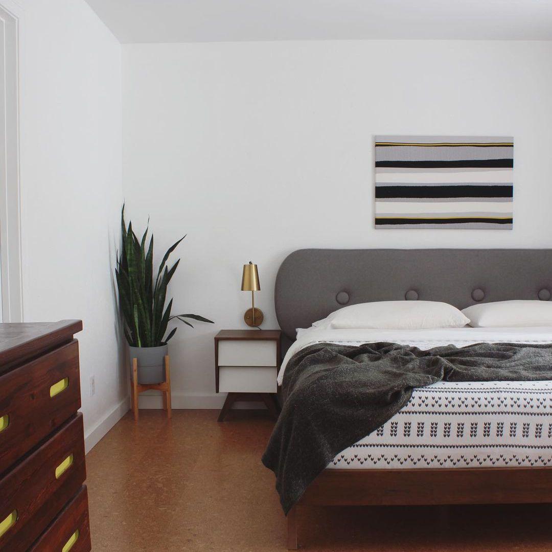 Bedroom with gray headboard
