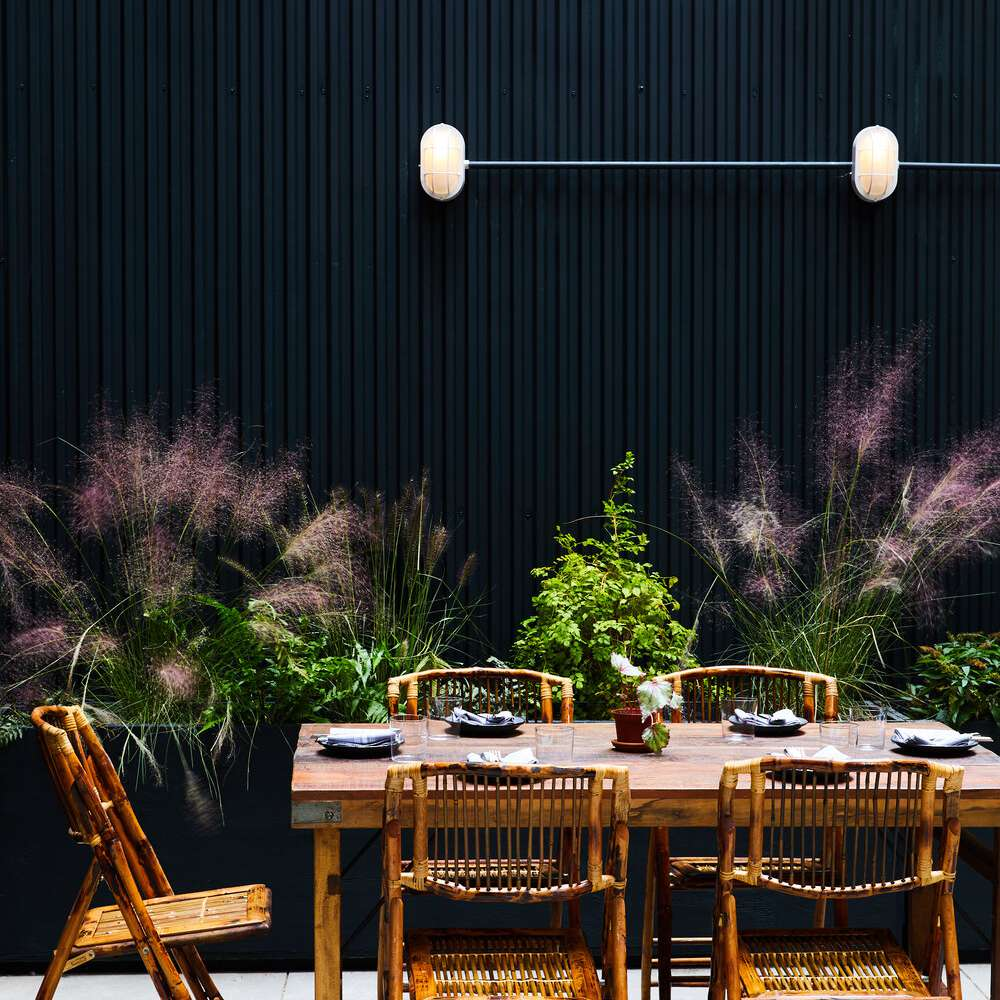 Outdoor patio with black wall.