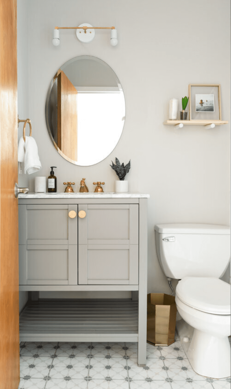 Modern bathroom with floating wood shelf with vignette, oval mirror