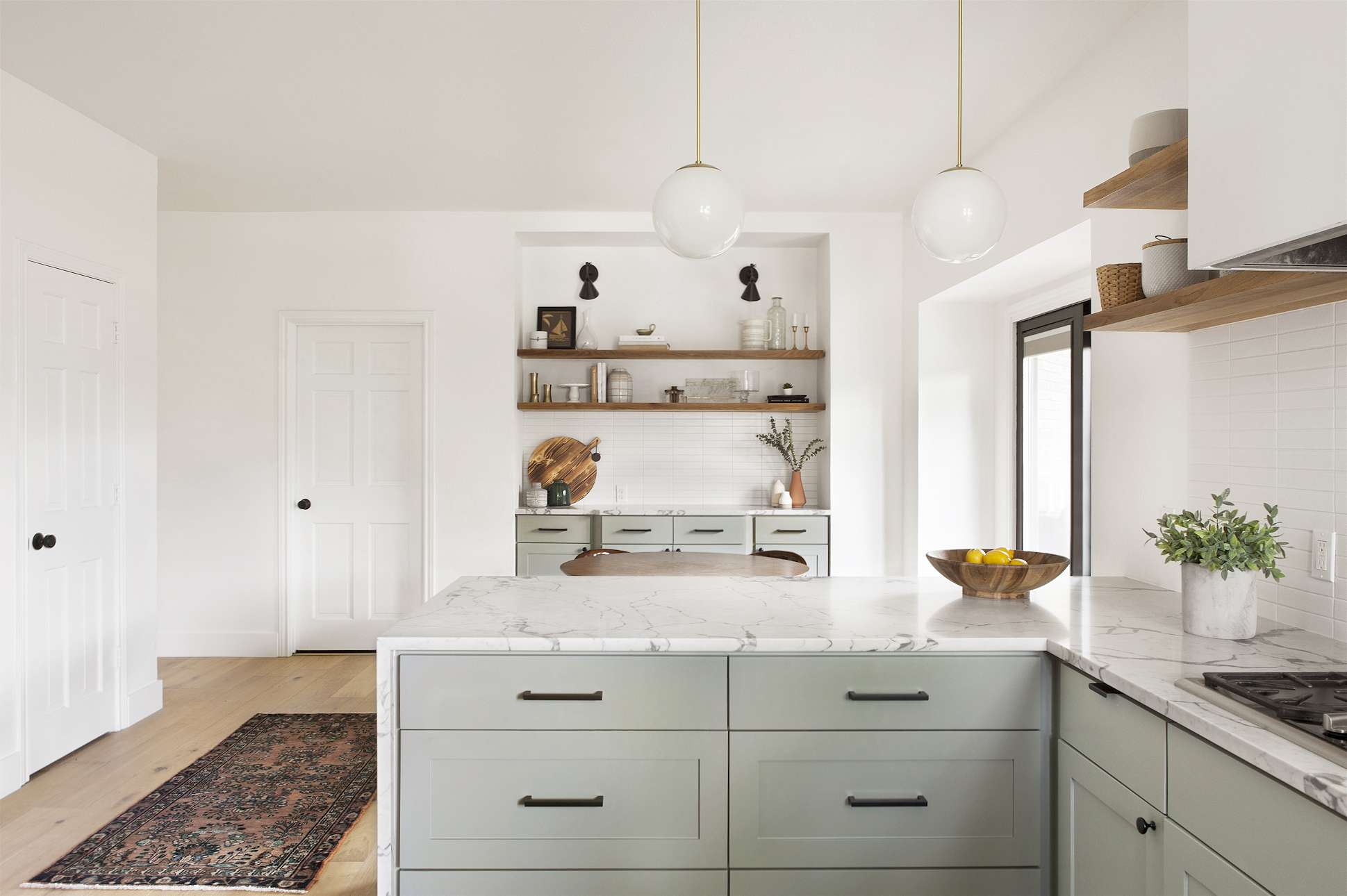 Mid-Century Modern style kitchen with white globe light fixtures