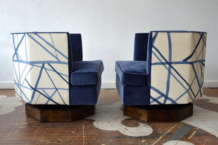 A pair of eclectic 1970s swivel chairs covered in a modern graphic fabric and blue velvet.