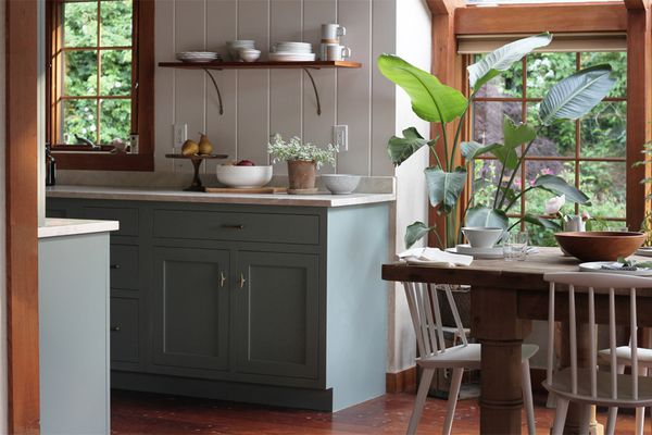 A kitchen with light blue cabinets