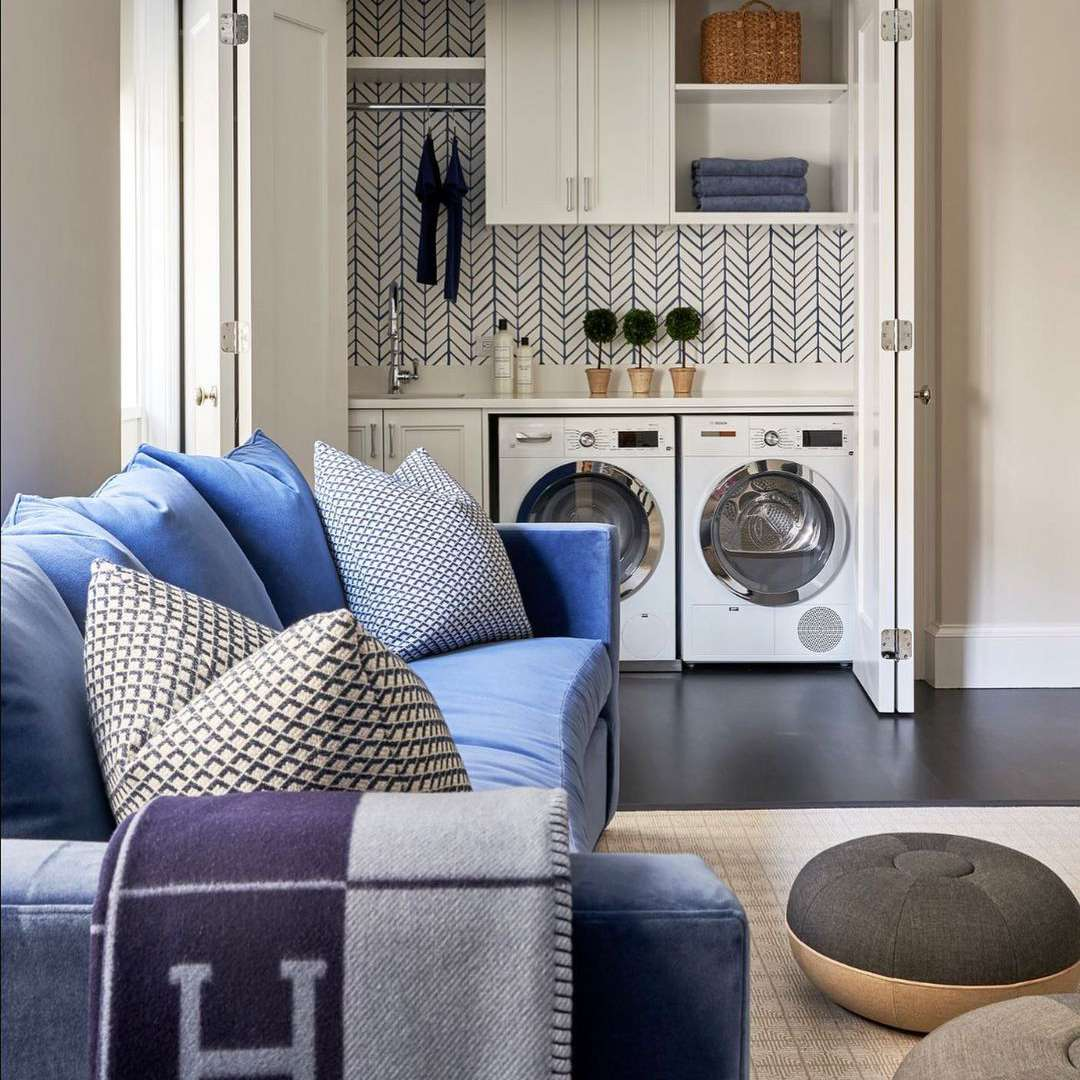 Laundry room in a living room closet