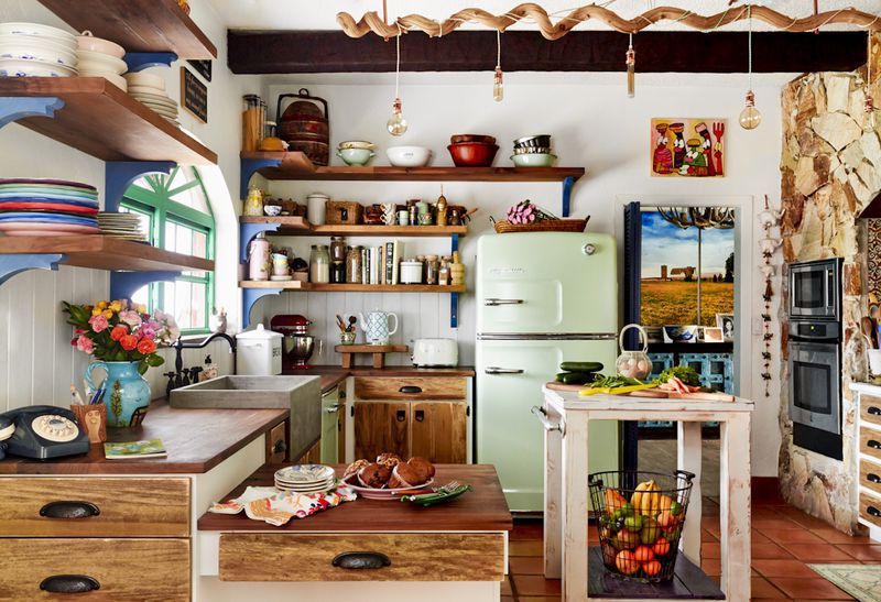 Colorful kitchen with green refrigerator