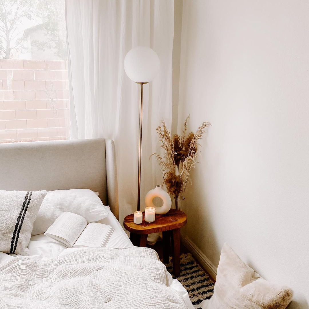 Bed with candles on the side table