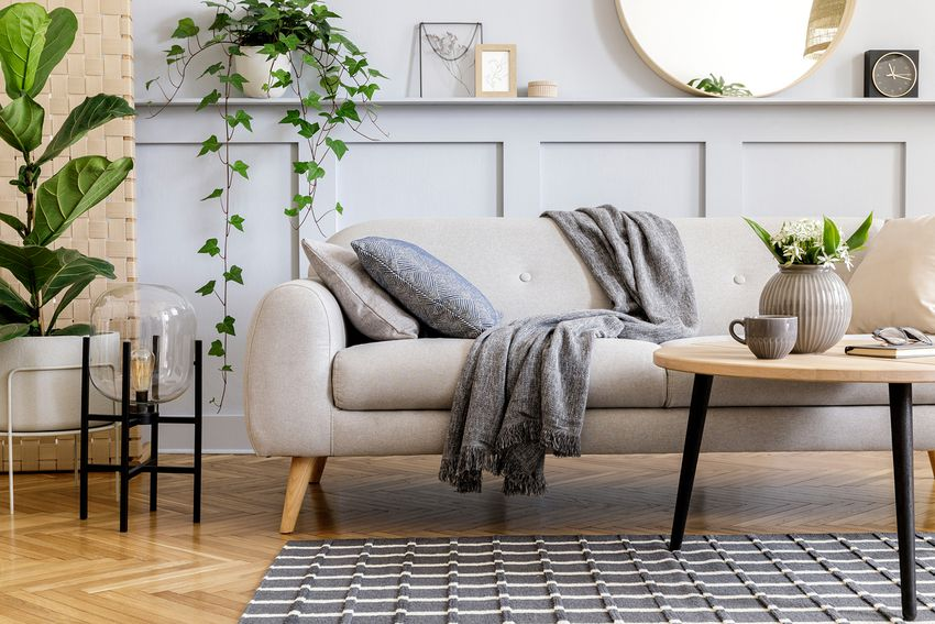 Scandinavian concept of living room interior with design sofa