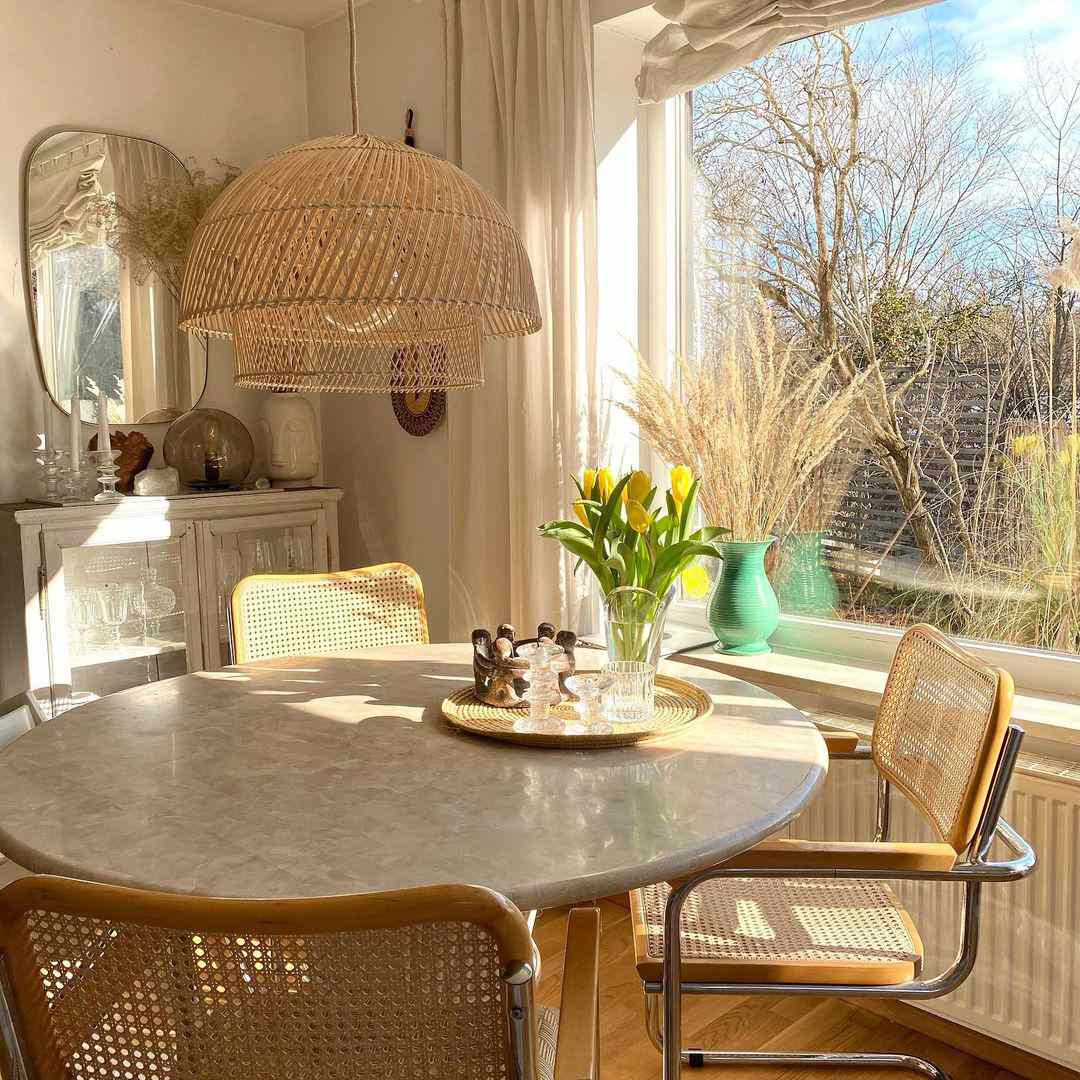 Rattan chairs around dining table