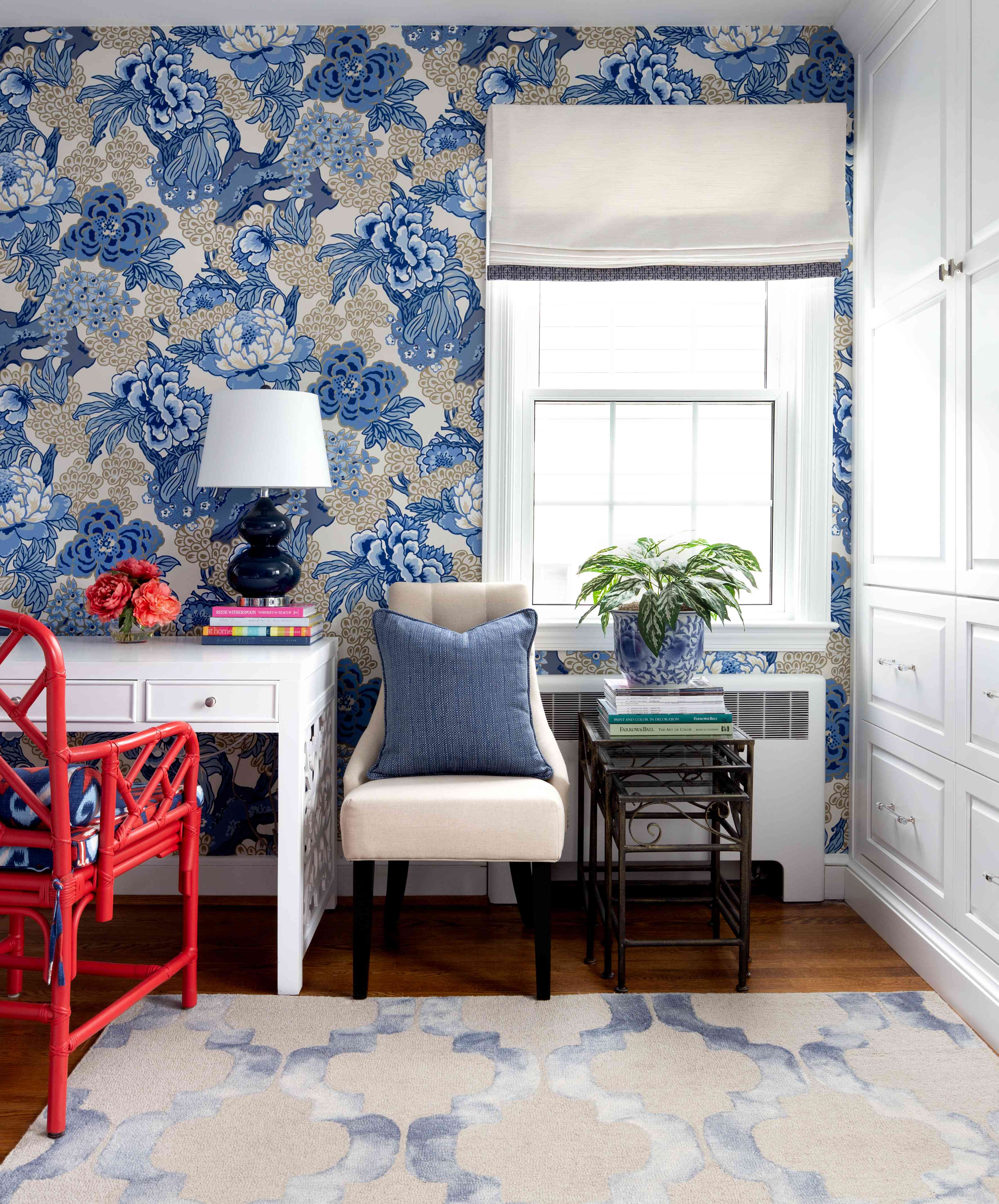 Blue wallpaper bedroom with delicate accents.