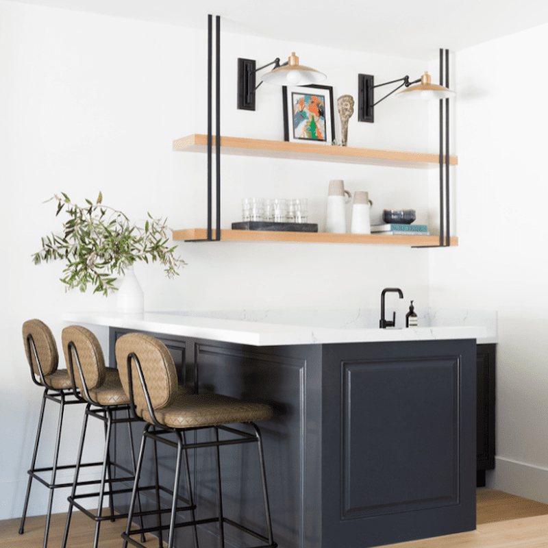 A small kitchen with hanging kitchen shelves