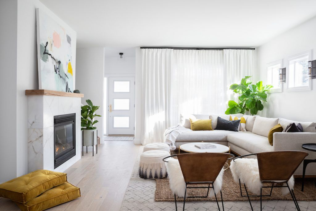 A modern bright living room with boho touches