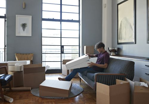 man in house with boxes