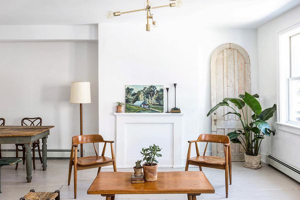living room with white painted wood floors