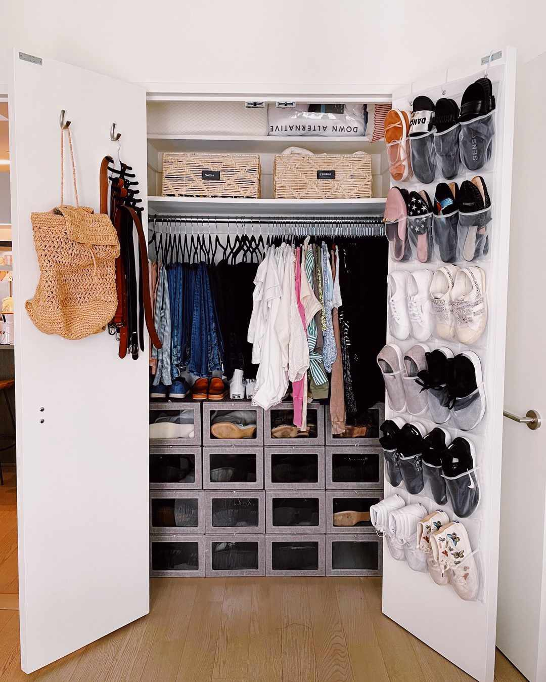 Closet with shoes on the back of the door