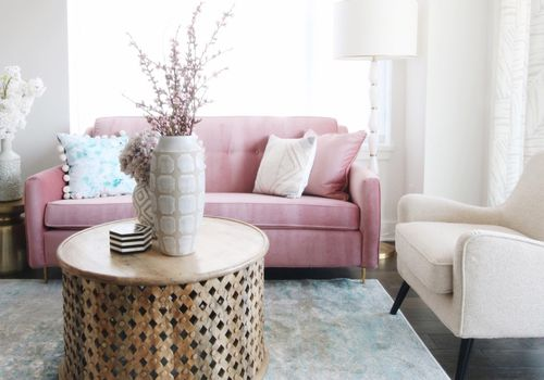 Pink sofa in a calming living room.