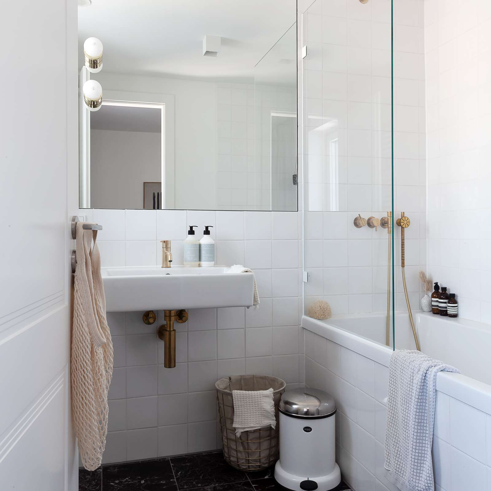 White bathroom with marble floor