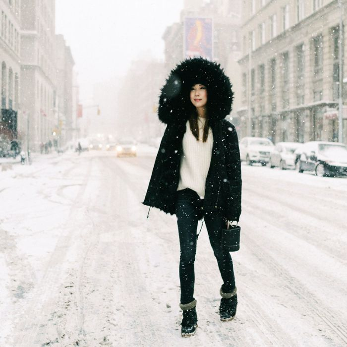 a woman standing outside in the snow
