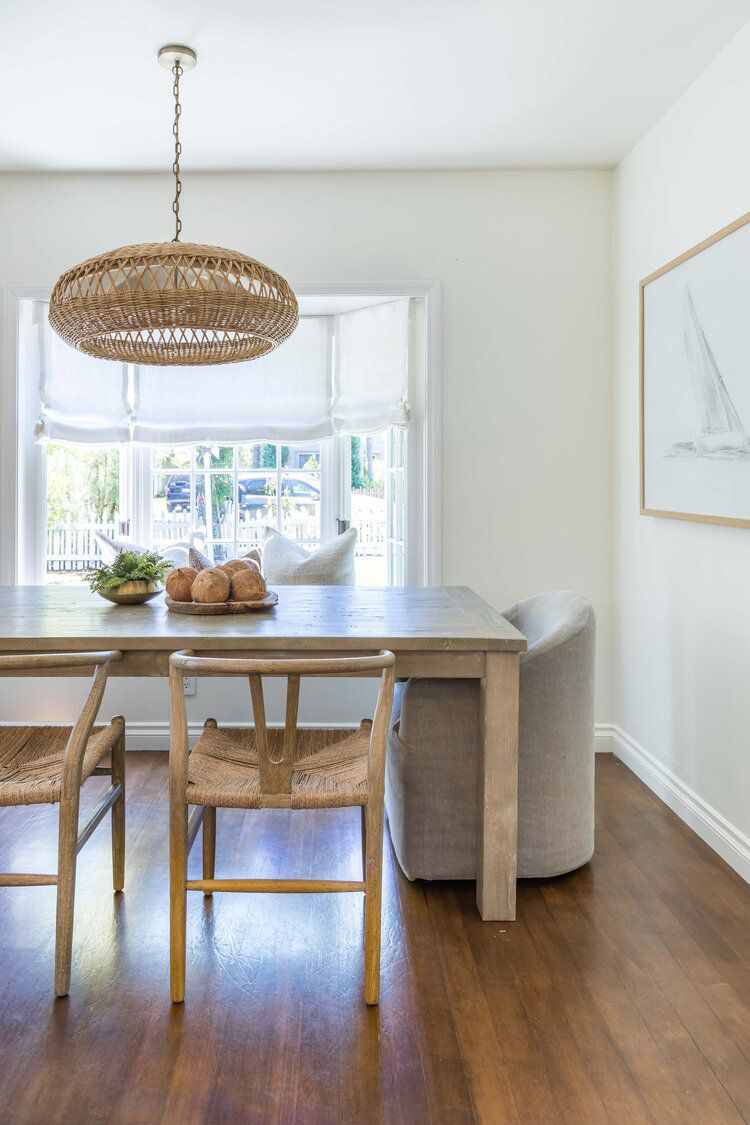 history of wishbone chairs - two chairs in front of dining room table