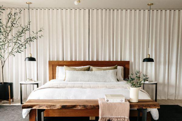 Bedroom with modern light fixture