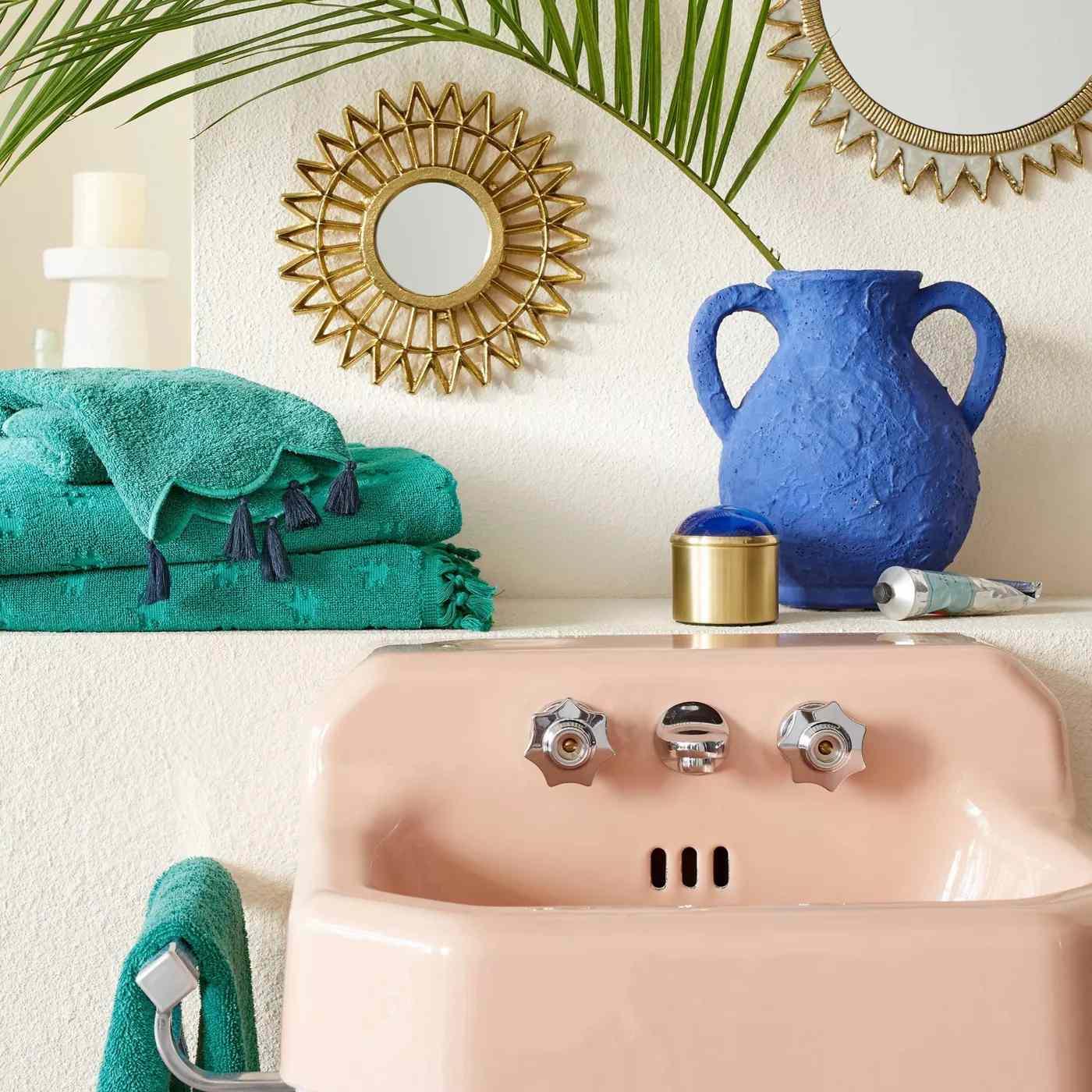 Jacquard Bath Towel with Fringe atop sink.