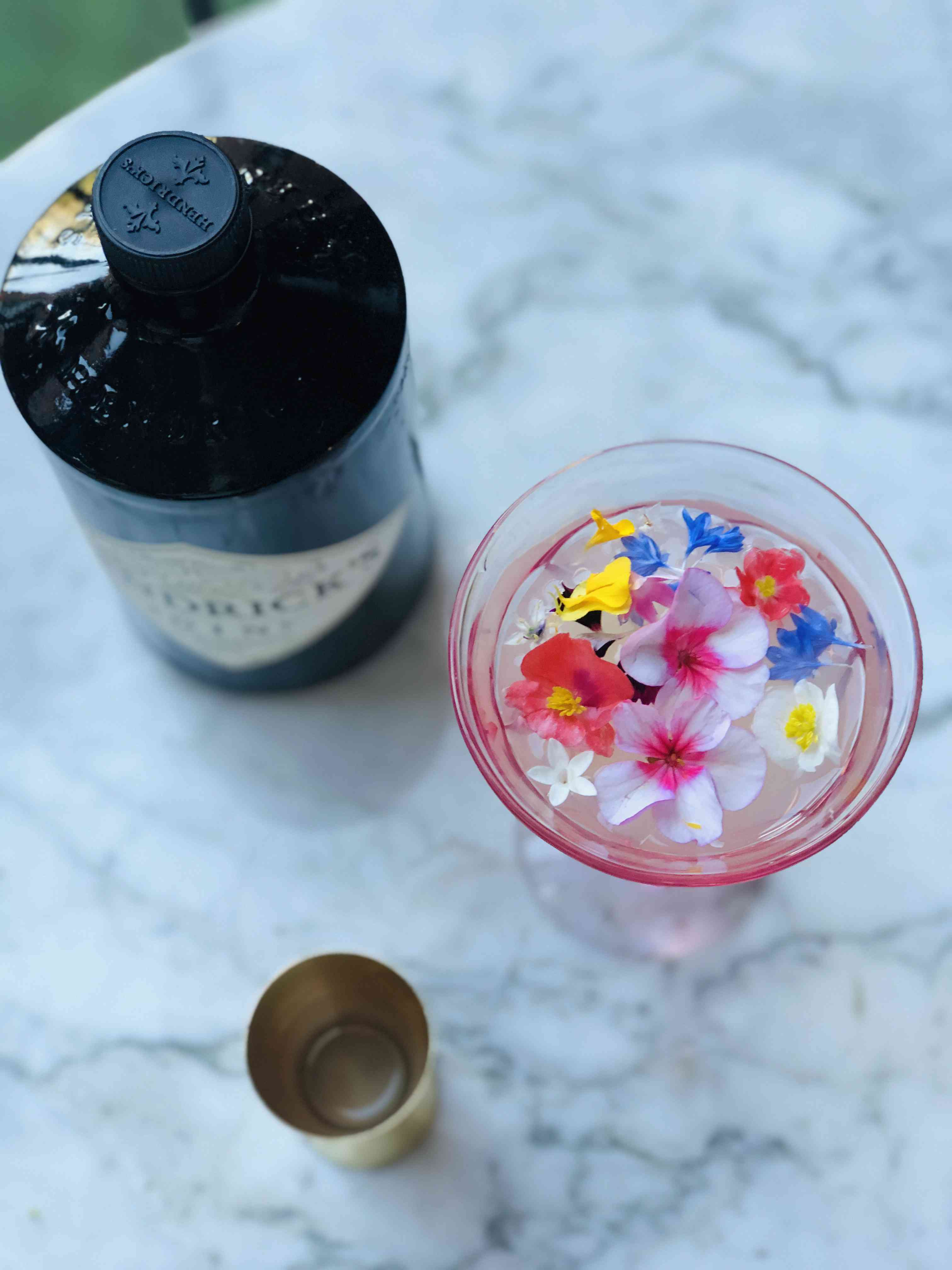 Close-up on drink with edible flowers.