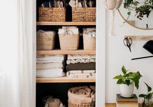 hall closet with no door and linens