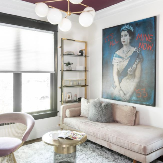 Sitting room with burgundy ceiling and blush pink sofa
