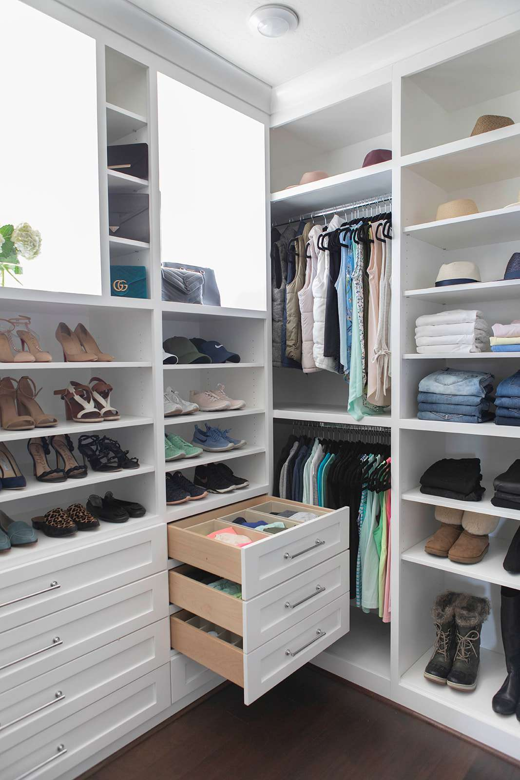 Walk-in closet with organized drawers