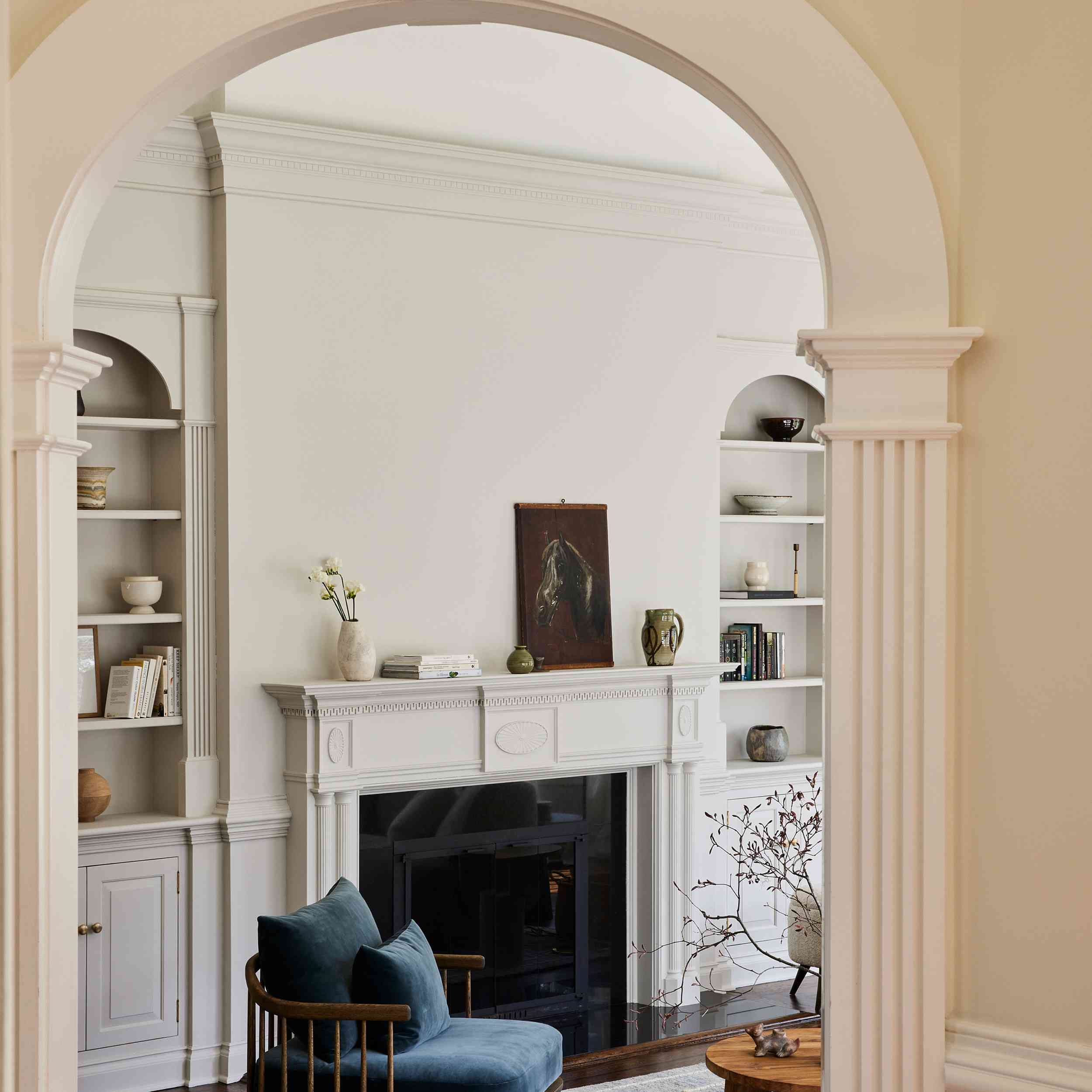 connecticut farmhouse home tour - living room entrance featuring arched doorways