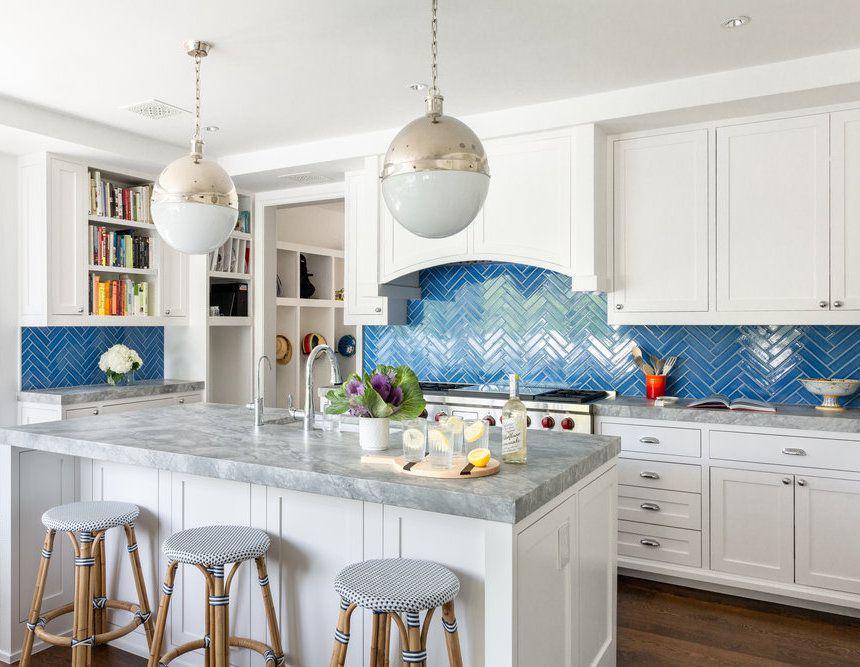 Blue herringbone tile backsplash