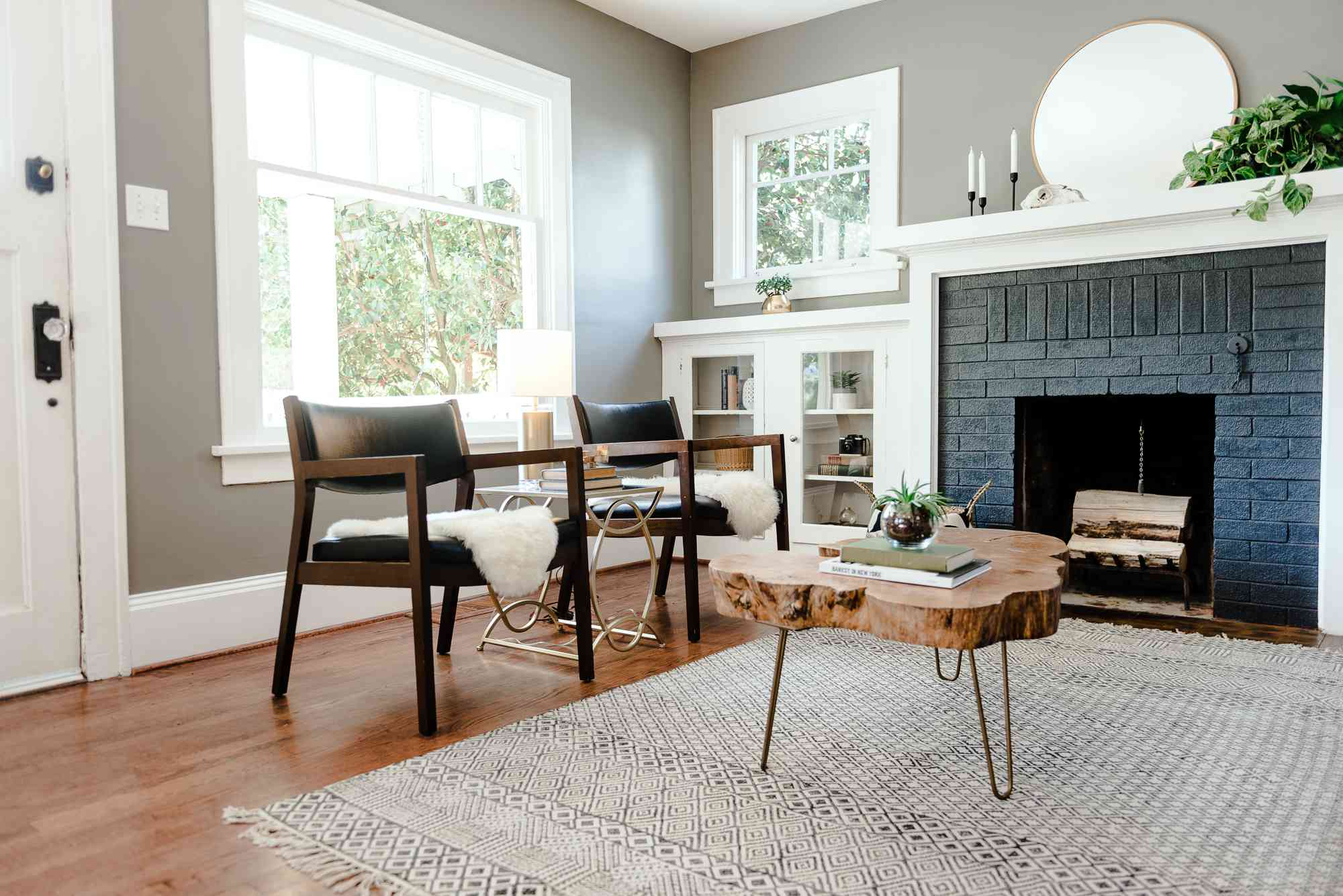 Sitting room with rustic wood coffee table and wooden armchairs.